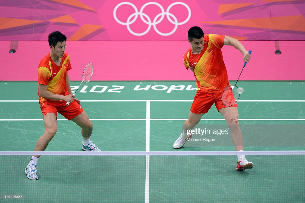 <a gi-track='captionPersonalityLinkClicked' href=/galleries/search?phrase=Haifeng+Fu&family=editorial&specificpeople=647789 ng-click='$event.stopPropagation()'>Haifeng Fu</a> (R) and Yun Cai (L) of China look to return a shot against Glenn Warfe and Ross Smith of Australia during their Men's Doubles Badminton on Day 1 of the London 2012 Olympic Games at Wembley Arena on July 28, 2012 in London, England.
