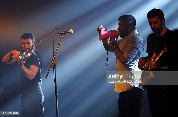 Haig Papazian Hamed Sinno and Ibrahim Badr of Lebanese alternative rock band Mashrou' Leila perform on stage at the 39th 'Le Printemps de Bourges'...