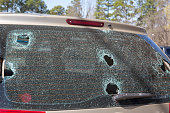 Hail damage or wrecked broken back auto glass shattered needs repair