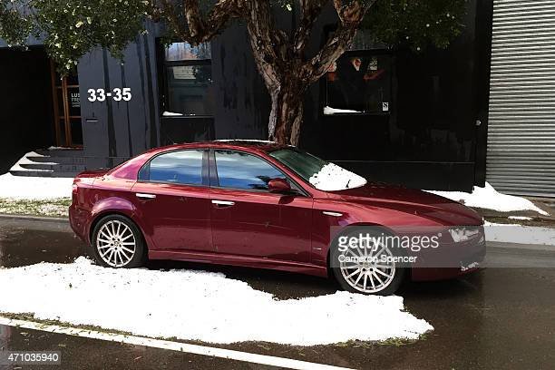 Hail is seen on a vehicle and on the road in the suburb of Alexandria on April 25 2015 in Sydney Australia Large areas of Sydney have been hit by a...