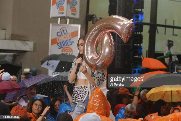 Hailee Steinfeld takes a moment to celebrate 6 Million Instagram hits when she performs in the rain on NBC's 'Today' Show at Rockefeller Plaza on...