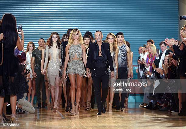 Hailey Baldwin and Julien Macdonald walk the runway at the Julien Macdonald show during London Fashion Week Spring/Summer collections 2016/2017 on...