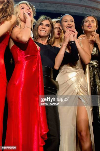 Hailey Baldwin Carine Roitfeld and Bella Hadid are seen onstage the amfAR Gala Cannes 2017 at Hotel du CapEdenRoc on May 25 2017 in Cap d'Antibes...