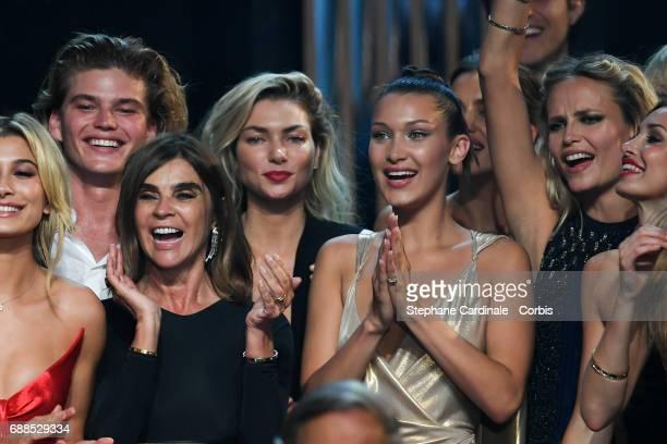 Hailey Baldwin Jordan Barrett Carine Roitfeld Hana Jirickova Bella Hadid and Natasha Poly are seen on stage during the amfAR Gala Cannes 2017 at...