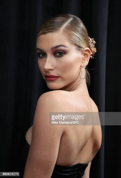 Hailey Baldwin poses in the winners room during The Fashion Awards 2017 in partnership with Swarovski at Royal Albert Hall on December 4 2017 in...