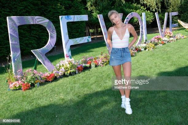 Hailey Baldwin toasts to #REVOLVEintheHamptons with Moet Chandon on July 4 2017 in Bridgehampton New York
