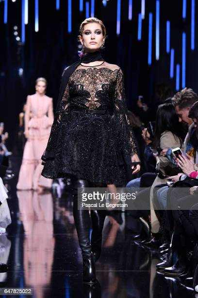 Hailey Baldwin walks the runway during the Elie Saab show as part of the Paris Fashion Week Womenswear Fall/Winter 2017/2018 on March 4 2017 in Paris...