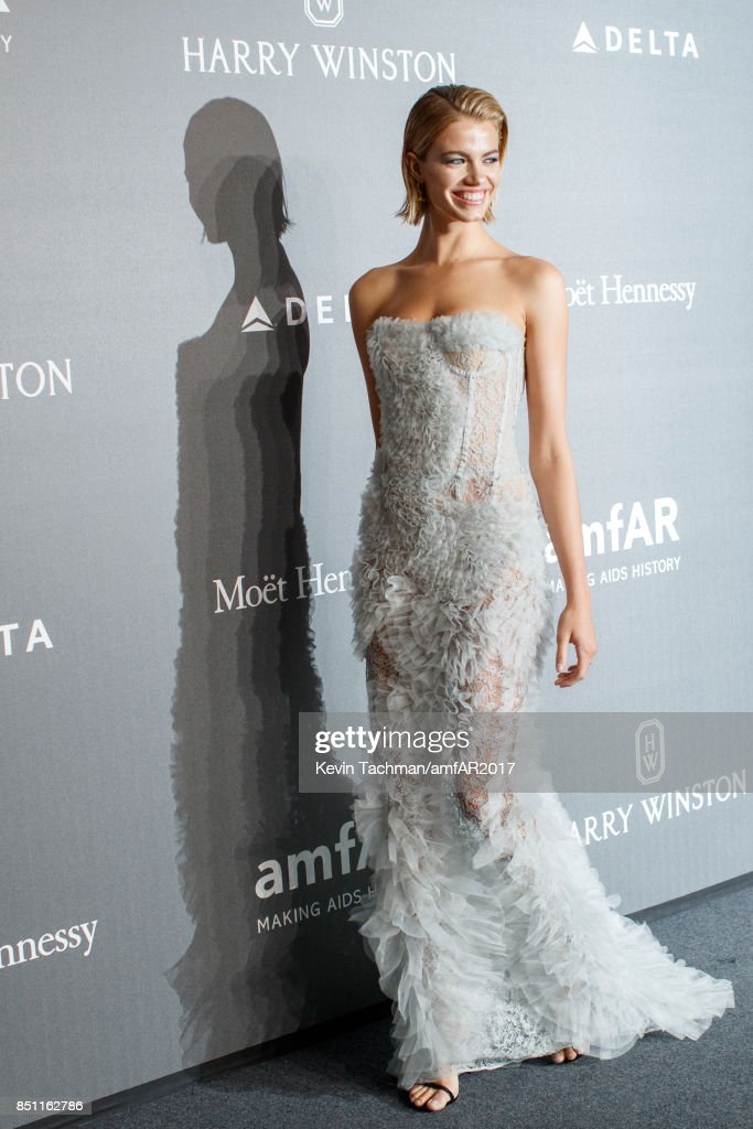 Hailey Clauson walks the red carpet at the amfAR Gala Milano on September 21, 2017 in Milan, Italy.
