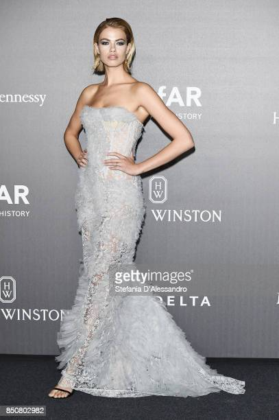 Hailey Clauson walks the red carpet of amfAR Gala Milano on September 21 2017 in Milan Italy