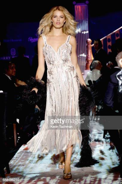 Hailey Clauson walks the runway at the amfAR Gala Cannes 2017 at Hotel du CapEdenRoc on May 25 2017 in Cap d'Antibes France