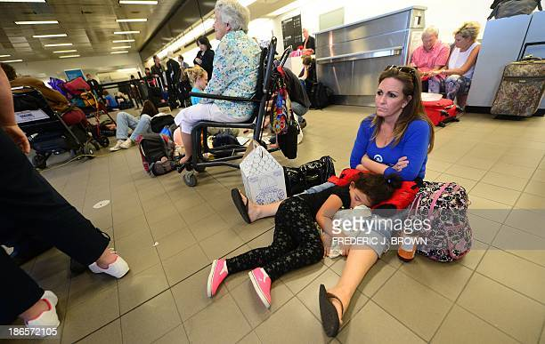 Hailey Gomez naps in her mother Christine's arms after their flight home to Hawaii this moring had been delayed inside Terminal 1 at Los Angeles...