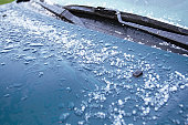 Hailstones Melting on Car Hood