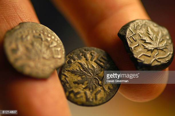 Haim Gitler curator of numismatics at the Israel Museum shows coins dated to the ancient Jews' Great Revolt against Roman rule in 66 AD decorated...
