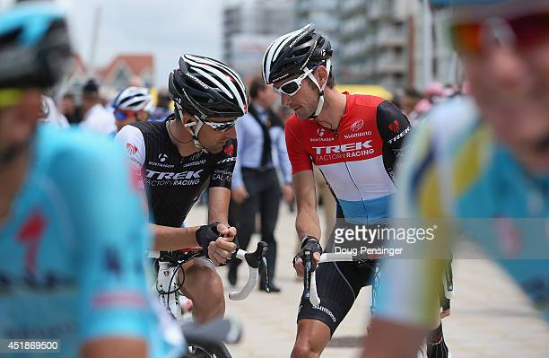 Haimar Zubeldia of Spain and Trek Factory Racing and Frank Schleck of Luxembourg and Trek Factory Racing talk before the start of stage four of the...