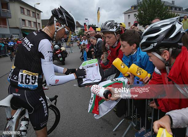 Haimar Zubeldia of Spain and Trek Factory Racing signs autographs for young fans at the start of stage nine of the 2014 Le Tour de France from...