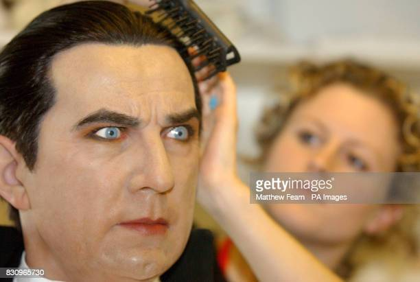 Hair and colouring artist Zoe Walton brushes the hair of Count Dracula at Madame Tussaud's in London The Count which is borrowed from Tussaud's New...