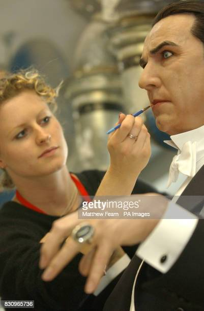 Hair and colouring artist Zoe Walton brushes the lips of Count Dracula at Madame Tussaud's in London The Count which is borrowed from Tussaud's New...