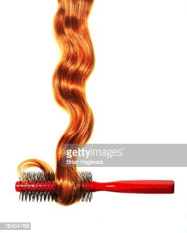 Hair coiling around brush : Stock Photo