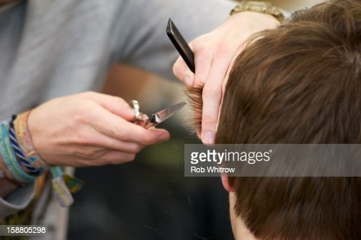 hair cut to young man close up : Stock Photo