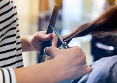 close-up of a women having her haircut, clean and beautiful hair.