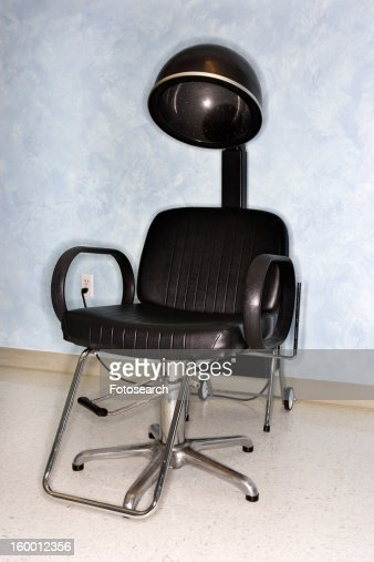Hair dryer chair at salon stock photo getty images - Salon chair with hair dryer ...
