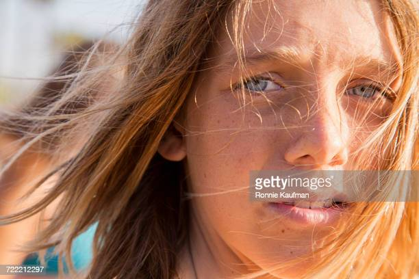 Hair of Caucasian boy blowing in wind