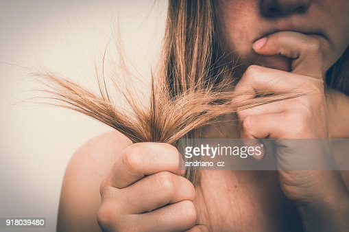 Hair problems - brittle, damaged, dry and loss hair concept : Stock Photo