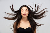 Hair salon. Beauty Fashion Model Woman  Healthy Brown Hair looking at camera. Hairdresser,hairstyle concept