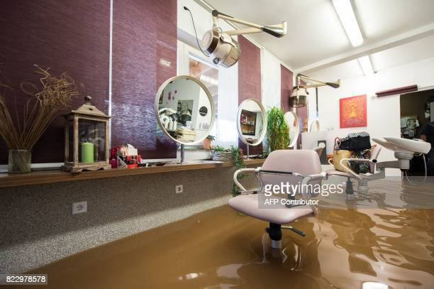 TOPSHOT A hair salon is overflooded in Rhueden northern Germany on July 26 2017 Some parts of lower saxony are overflooded after heavy rainfall / AFP...