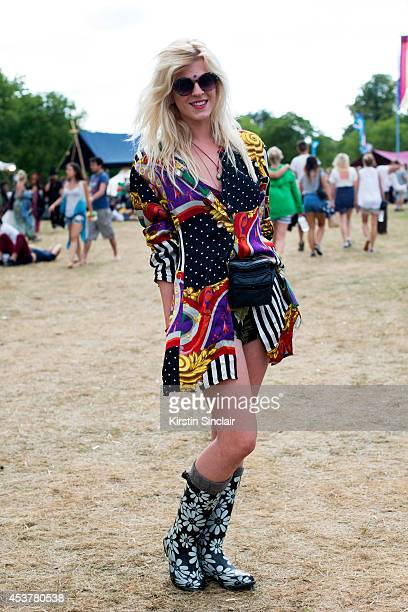 Hair Salon Manager Danni Watt wearing Urban Outfitters shades Primark boots and a vintage shirt bag and shorts at Wilderness Festival on August 09...