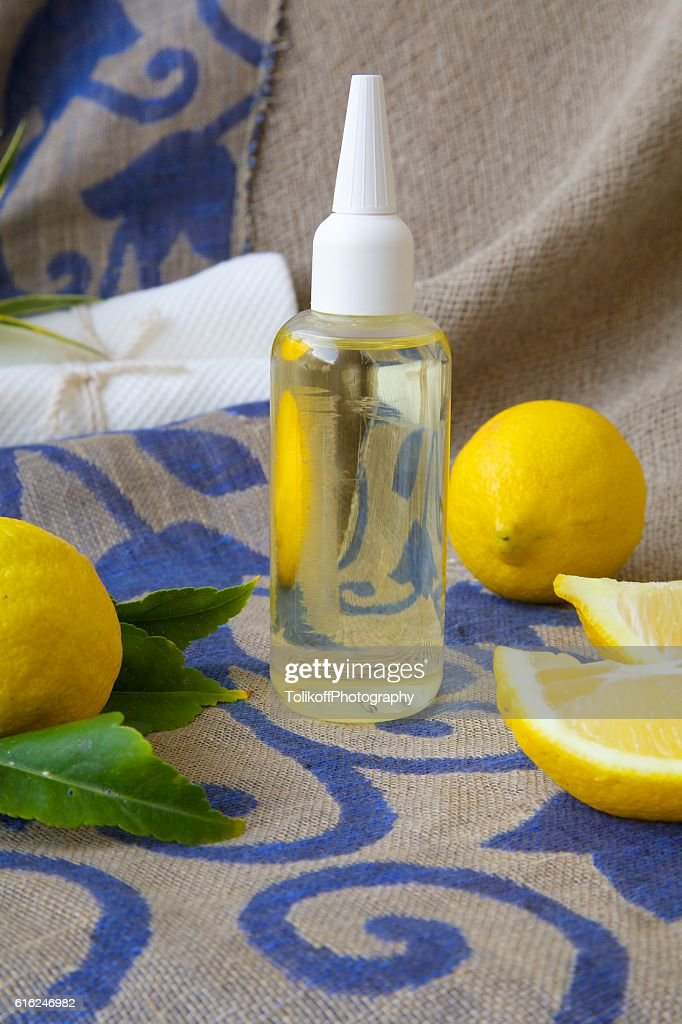 Hair serum with lemon essential oil : Stock Photo