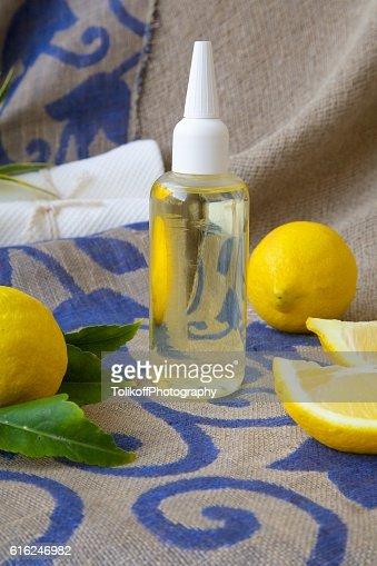 Hair serum with lemon essential oil : Stock Photo