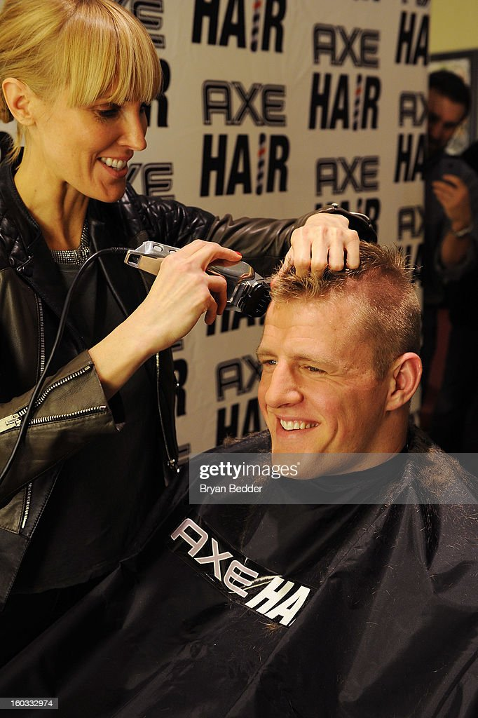 Hair spokestylist Amy K gives defensive end J.J. Watt a spiked-up look using a new line of AXE hair products at Truman's on January 29, 2013 in New York City.