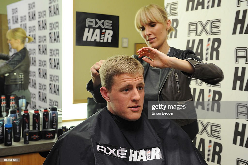 Hair spokestylist Amy K prepares to give defensive end J.J. Watt a spiked-up look using a new line of AXE hair products at Truman's on January 29, 2013 in New York City.
