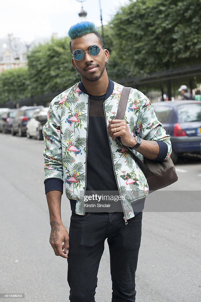 Hair styilist Jason Lee Preston wearing a Zara jacket, H and M jeans and vintage sunglasses on day 1 of Paris Collections: Men on June 25, 2014 in Paris, France.