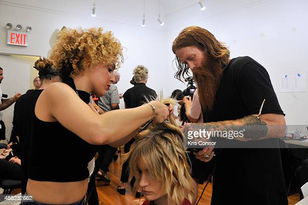 Hair stylist Aaron Grenia prepares backstage during the 'Victor de Souza Spring 2016 Ready To Wear Collection' at the MECCA Center on September 14...