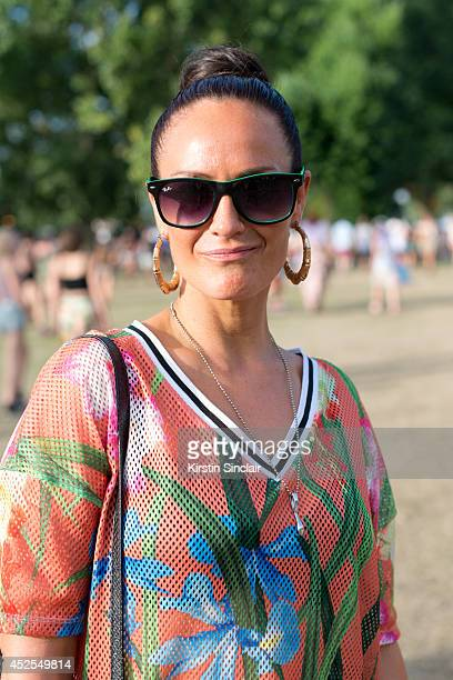 Hair stylist Bianca Ustiana wearing a River Island dress and Ray ban sunglasses at Lovebox 2014 on July 18 2014 in London England