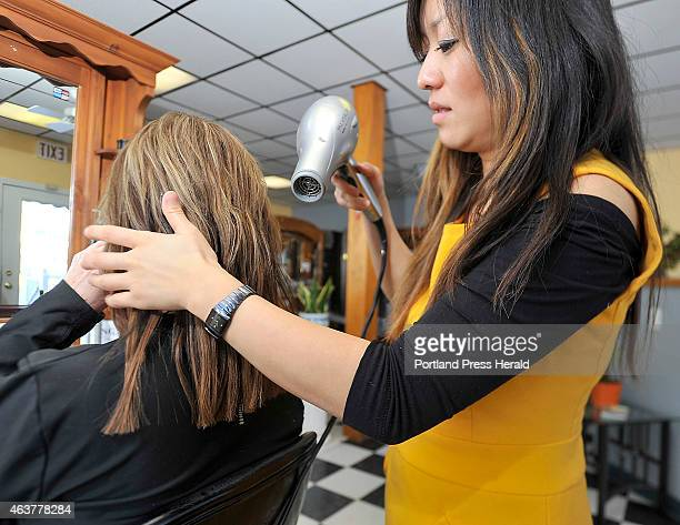 Hair stylist Jincheng Kong blowdries the blended hair and extensions for a natural style