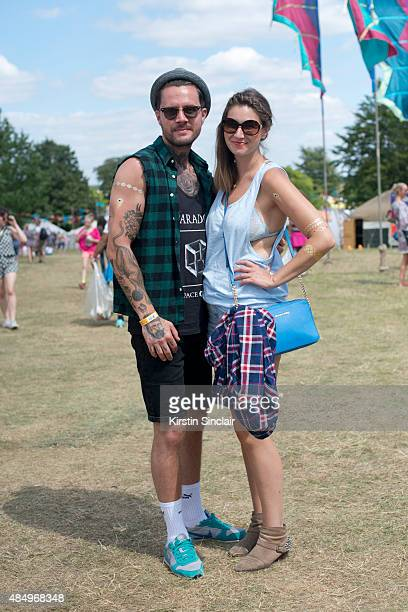 Hair Stylist Phil Marsh wears an Asos shirt Top Man Vest and Hat H and M shorts Nike Trainers and Ray Ban sunglasses with Fashion Buyer Adele Horne...