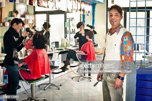 Hair stylist standing in salon