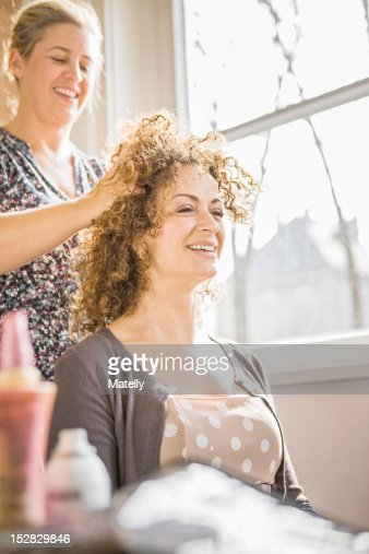 Hair stylist working on client : Stock Photo