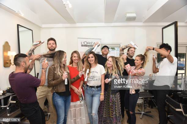 Hair stylists pose at L'Oreal Professionnel Hair Fashion Night at Ramirez Tran Salon on June 15 2017 in Beverly Hills California