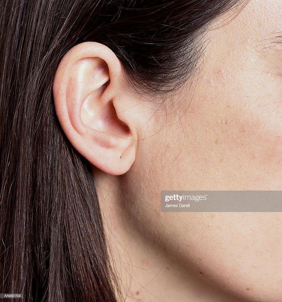 Hair tucked behind ear, close-up