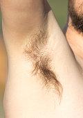 Hair under the armpit of a man .
