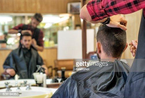 Hairdresser Checking Customer's Hair