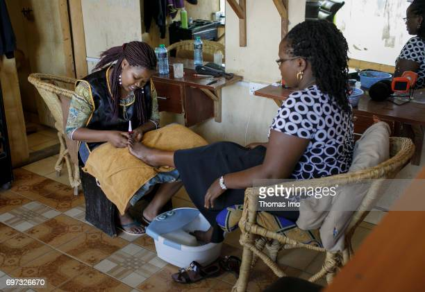 Hairdresser Emma Kinyanjui operator of a barber and cosmetic salon at work on May 17 2017 in Talek Kenya