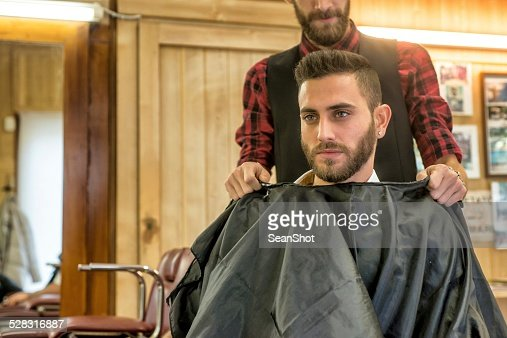 Hairdresser Fastening Mantilla at His Customer