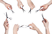 Set of hairdresser hands holding scissors for cutting hair isolated on white background