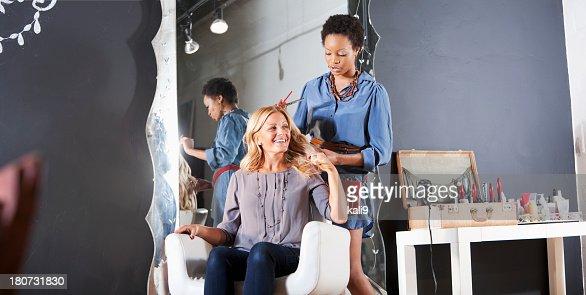 Hairdresser in salon with customer