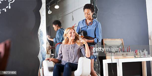 Hairdresser in salon with customer
